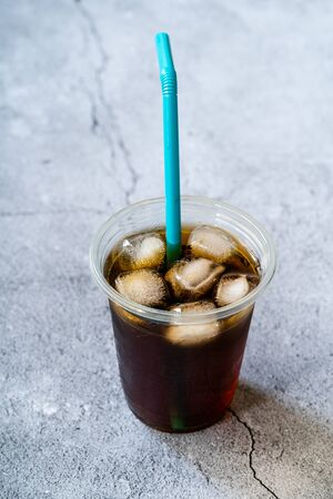 Take Away Cold Brew Coffee with Ice in Plastic Glass and Straw For Summer.