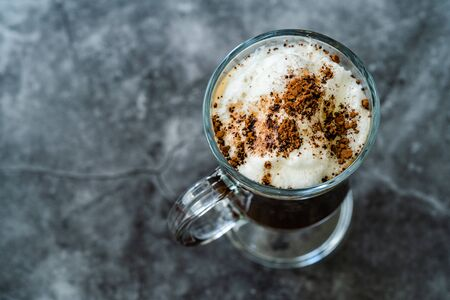 Homemade Alcoholic Amaretto Coffee with Cognac and Whipped Cream. Ready to Drink. Stock Photo