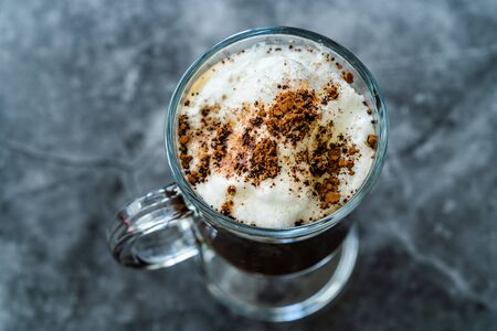 Homemade Alcoholic Amaretto Coffee with Cognac and Whipped Cream. Ready to Drink.