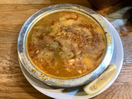 Turkish Soup Beyran with Lamb Meat, Rice, Chopped Garlic and Vinegar Sauce in Local Restaurant. Traditonal Dish. 版權商用圖片