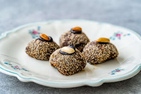 Traditional Turkish Dessert Balbadem / Bal Almond also Called Chocolate Sekerpare with White Poppy Seeds, Sherbet and Peanut. Ready to Eat.