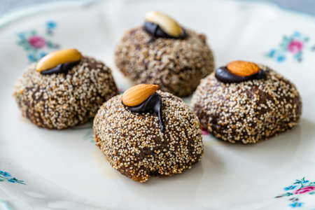 Traditional Turkish Dessert Balbadem / Bal Almond also Called Chocolate Sekerpare with White Poppy Seeds, Sherbet and Peanut. Ready to Eat. Reklamní fotografie