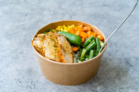 Take Away Healthy Organic Turkish Protein Bowl with Roasted Chicken Slices, Jasmine Rice, Cucumber, Chives, Green Peas, Carrot and Mayonnaise Yogurt Sauce in Plastic Cup Package / Container. Ready to Eat.