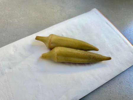 Pickled and Preserved Okra Pickle on Napkin Ready to Taste Organic Healthy Food. 版權商用圖片