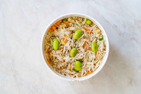 Take Away Boiled Steamed Basmati Rice with Edamame Beans in Plastic Cup Box Container. Traditional Healthy Organic Food.