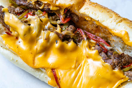 Philly Cheese Steak Sandwich with Melted Cheddar Cheese. Macro Close Up View. Ready to Eat Fast Food. Фото со стока