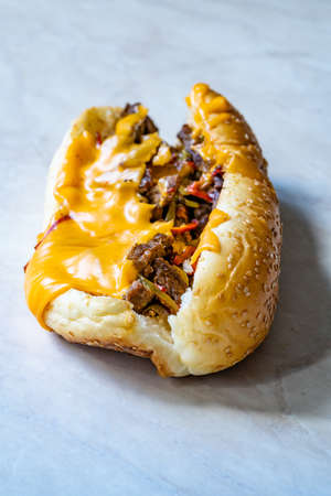 Philly Cheese Steak Sandwich with Melted Cheddar Cheese. Ready to Eat Fast Food. Фото со стока