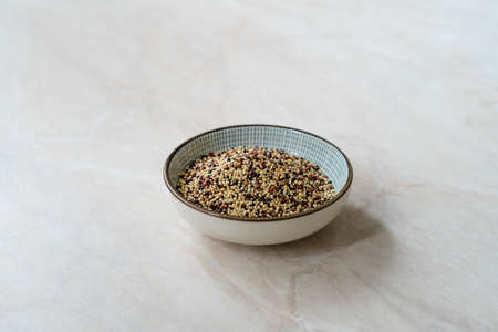 Raw Mixed Tricolor / Three Color Quinoa in Bowl. Ready to Use.