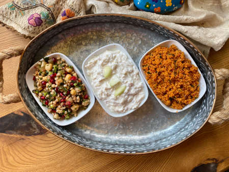 Traditional Appetizer Bulgur or Bulghur Kisir, Celery Salad and Chickpea Lentil Salad. Turkish Greek Food in Copper Tray at Local Restaurant. Ready to Eat. Imagens