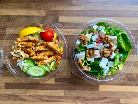 Take Away Salad in Plastic Container Bowl for Take Out Delivery. Ready to Eat and Serve.