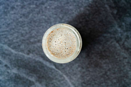 Take Away Homemade Almond Milk in Bottle with Vanilla Extract and Cinnamon Powder. Take Out. Ready to Drink. Standard-Bild