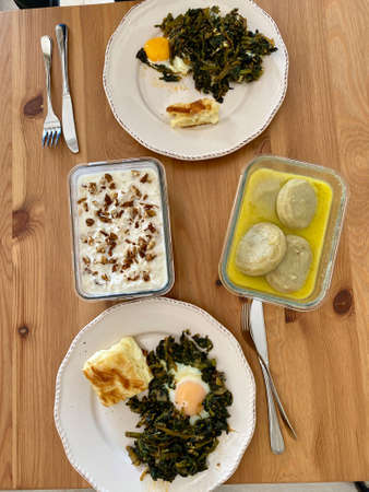 Healthy Organic Food Table with Spinach Egg, Artichoke and Yogurt Celery on Wooden Table. Ready to Eat and Serve. Standard-Bild