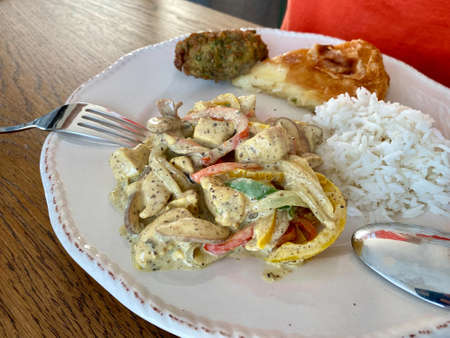 Homemade Chicken with Black Truffle, Curry sauce and served with Basmati Rice. Ready to Eat. Stock Photo