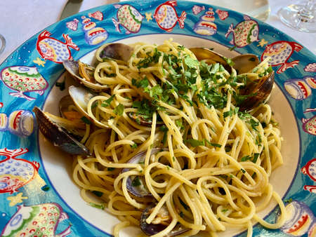 Cooked Grooved Carpet Shell Seafood Spaghetti with Mussels. Served at Local Restaurant. Stock Photo