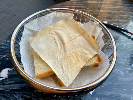Papadum Flatbread Crackers served at Restaurant as Appetizer. Ready to Serve in Metal Basket.