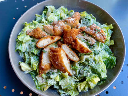 Healthy Organic Caesar Salad with Chicken, Parmesan Cheese, Yogurt and Mayonnaise Sauce. Ready to Eat.