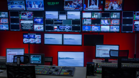 Video Switcher and a lot of Screens for Broadcasting Live at Tv Control Room 版權商用圖片 - 82693078
