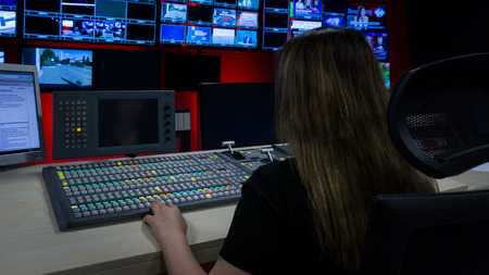 Video Switcher and a lot of Screens for Broadcasting Live at Tv Control Room Reklamní fotografie - 82693076