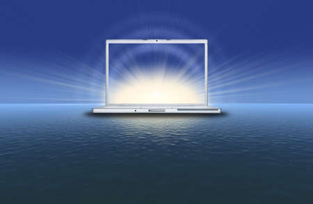 blank laptop computer on the sunset in the blue sea