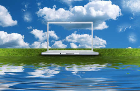 touchpad: blank laptop computer on the green grass isolated on a white Stock Photo