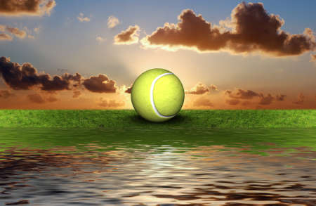 foot path: tennis ball on the green grass with sky background Stock Photo