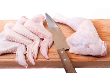 uncooked chicken on a wooden cutting board Stock Photo - 6306267