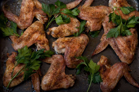 fried chicken wings on frying pan photo