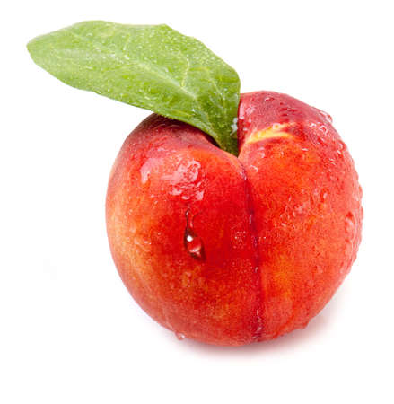 red peach with water drops on a white background