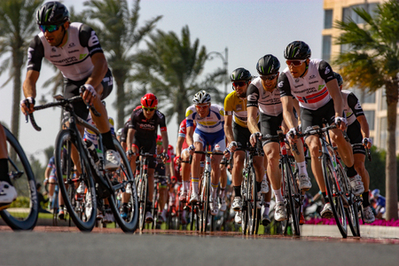 qatar: DOHA, QATAR FEBRUARY 9, 2016 -- Cyclists enter Porto Arabia roundabout on the second stage of the 2016 Tour of Qatar. Editorial