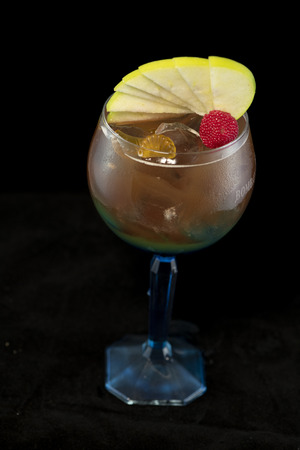 Special Iced Tea Cocktail with coke, light rum, blue curacao and sweet and sour with isolated black background Stock Photo