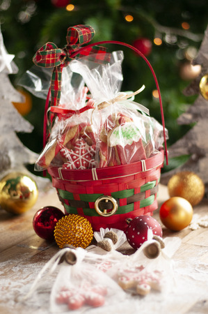 Christmas and New year gifts and baskets with sweets, alcohol, chocolate and cookies Standard-Bild