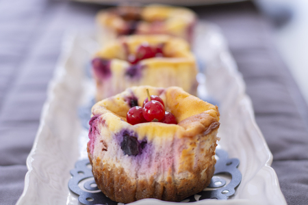 Muffins with fresh blueberry, blackberry, cranberry and strawberry pieces