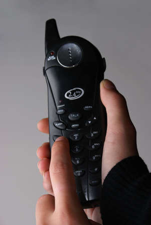 A close-up of a cordless telephone being dialed.                  photo