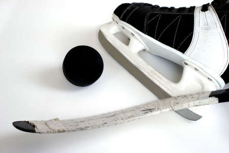 foot gear: A hockey skate, puck and stick.