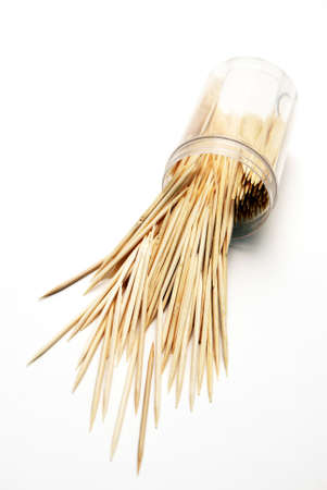 toothpick: A container of wooden toothpicks has spilled out. Stock Photo