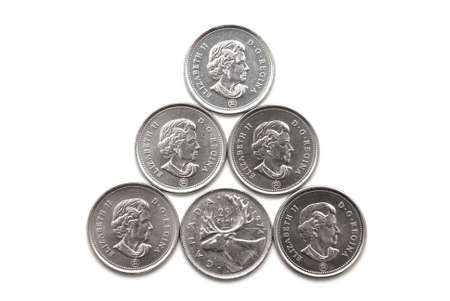 canadian currency: A pyramid of Canadian 25 cent coins. Stock Photo