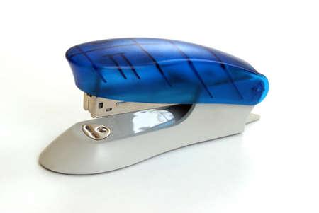 office stapler: An isolated stylish stapler over white background.