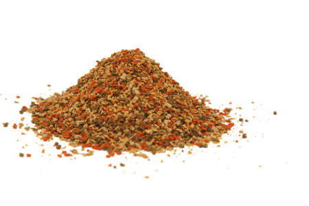 heaping: A heaping pile of pet fish food on a white background.