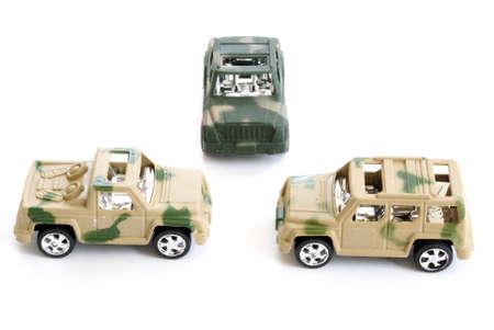 Three toy military vehicles on white background.