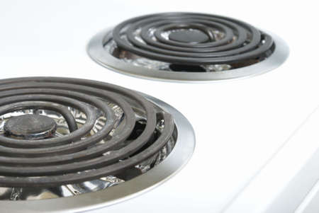 A macro of the top of a stove and its elements. photo