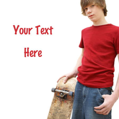 boy skater: A young teenage boy poses in the studio with his skateboard. Stock Photo