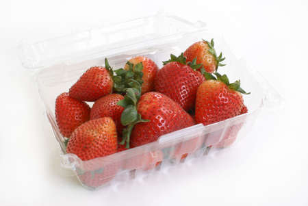 A basket of ripe strawberries on white background. photo
