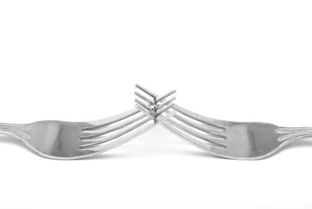 intertwined: Two forks are intertwined with eaach other. Stock Photo