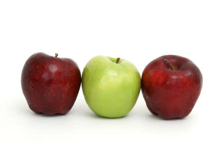 Three apples with the center one being green.