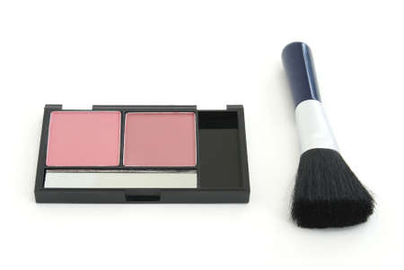 A two tone blush makeup set with an applicator brush.