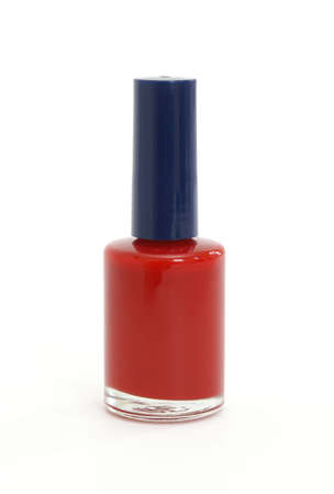 nail polish bottle: An isolated bottle of red nail polish.
