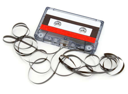 cassette tape: A cassette tape has been destroyed and the tape unraveled.