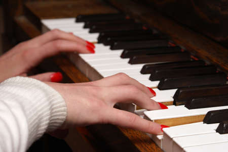 A macro shot of a woman playing the piano. Stock Photo - 5004251