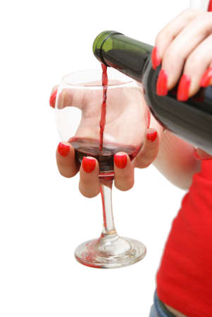 A woman is pouring a glass of red wine. photo