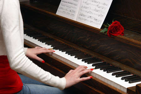 A macro of a woman playing the piano. Stock Photo - 5181689